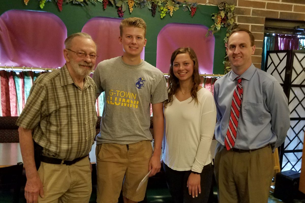 Kiwanis Youth Scholarships were awarded to Caleb Grossman and Marissa Block 9center) shown here at the Wednesday morning Kiwanis meeting. Kiwanis President Dwayne Kettering (left) and Todd Jex (right) are shown here.